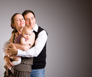Happy young parents with baby daughter